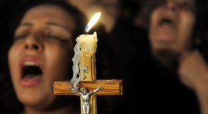 Reuters-Egypt-Coptic-Christians-candlelight-protest-photog-Stringer-Egypt